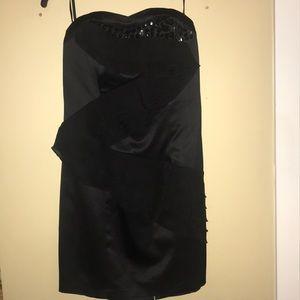Black strapless dress with ruffles and rhinestones